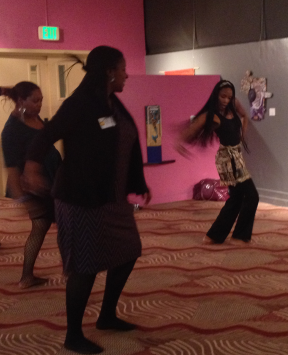 Teaching Artist Amani Manning shows Board member Yashica Crawford and a few other game partygoers some of the Afro-Peruvian dance moves our students learn.